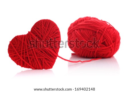 Red heart shape symbol made from wool isolated on white background - stock photo