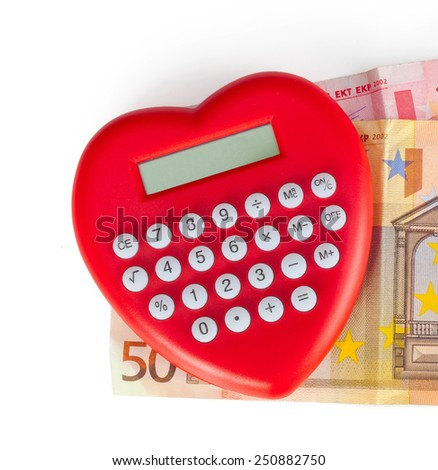 Red heart shaped calculator with euro banknotes. - stock photo