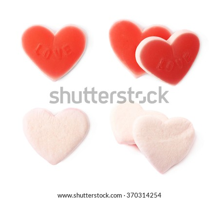 Red heart shaped candy isolated - stock photo