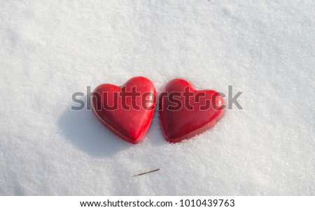red heart shaped figurines