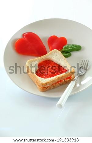 Red heart-shaped toast - stock photo