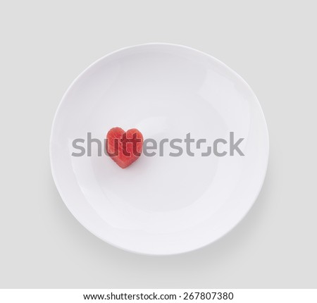 Red heart watermelon on plate isolated on gray  background with clipping path. - stock photo