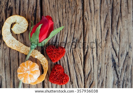 Red heart with rose on wooden background. - stock photo