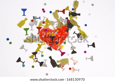 Red Heart with the party confetti on white - stock photo
