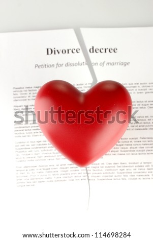 red heart with torn Divorce decree document, on white background close-up - stock photo