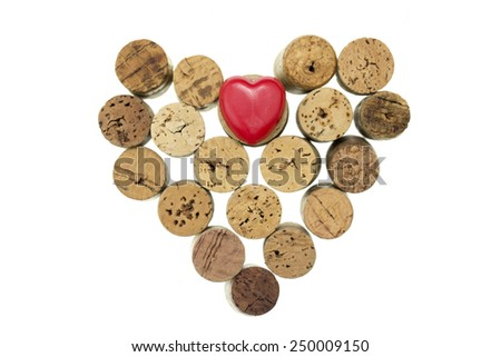Red heart with wine corks form a heart shape on isolated white - stock photo
