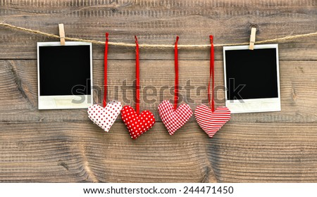 Red hearts and vintage photo frame. Handmade Valentine's Day decoration - stock photo