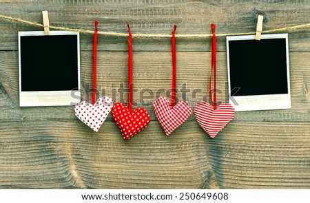 Red hearts and vintage photo frames. Valentines Day decoration - stock photo