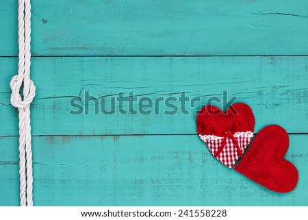 Red hearts border and white rope with knot on blank antique teal blue old weathered background - stock photo