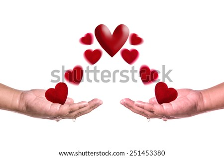 Red hearts fly into hands on white background . Love concept - stock photo