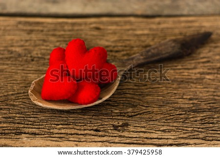 red hearts in wooden spoon