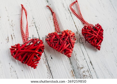 Red hearts made of wicker handmade on white background