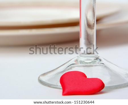 Red hearts near glass - stock photo