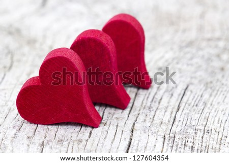 red hearts on old wooden background - stock photo