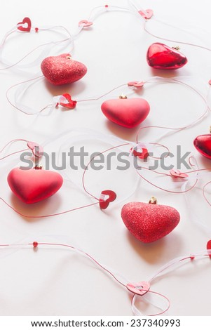 Red hearts on white background, selective focus