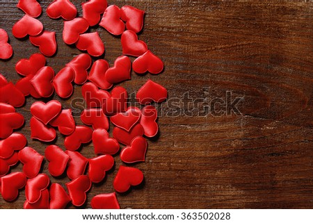 red hearts on wooden background - love concept
