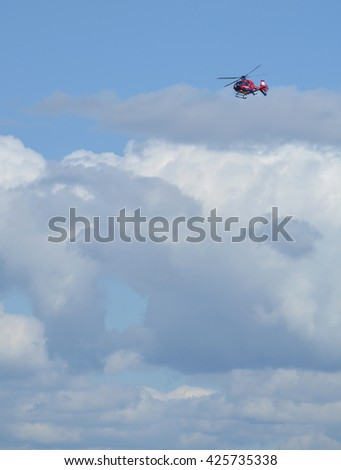 Red Helicopter in the sky - Copy space - stock photo