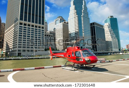 Red Helicopter ready to fly over Manhattan on a beautiful summer day - New York City. - stock photo
