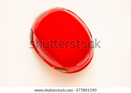 red helmet on white background. Top view. Climbing equipment.