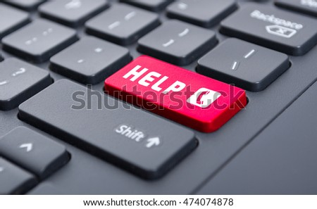 Red help with call symbol button on keyboard as emergency service concept