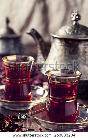 Red Hibiscus tea in turkish style - stock photo