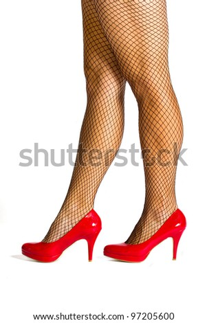 Red high hill shoes with black fishnet stockings - stock photo