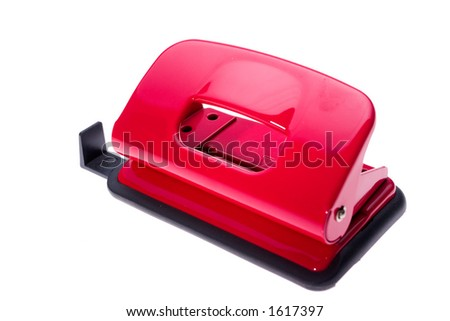 Red hole puncher in white background