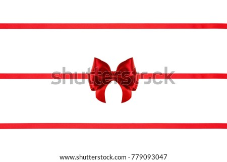 Red holiday silk ribbons with bows on white background