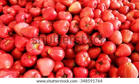Red honey guava background  tropical fruit with red, juicy flesh and a strong, sweet aroma.
