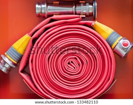 red hose fire - stock photo