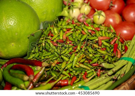 Red hot chili pepper cayenne, paprika. Fresh spice on basket . Healthy ripe spicy burning organic ingredient. - stock photo