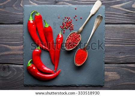 Red hot chili pepper on wooden background - stock photo