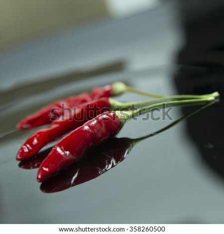 Red hot chili peppers collection over dark blue canvas background - stock photo