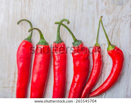 Red Hot Chili Peppers on a white wooden table - stock photo