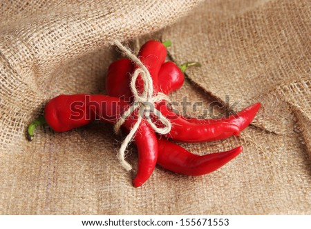 Red hot chili peppers on sackcloth, background