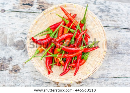 Red hot chili peppers on wood - stock photo