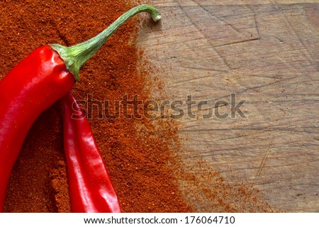 Red hot chili Peppers on wooden board abstract background - stock photo