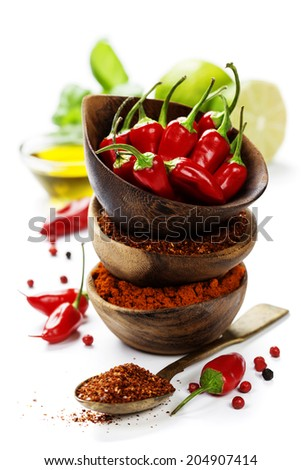 Red Hot Chili Peppers with herbs and spices over white background - cooking or spicy food concept - stock photo