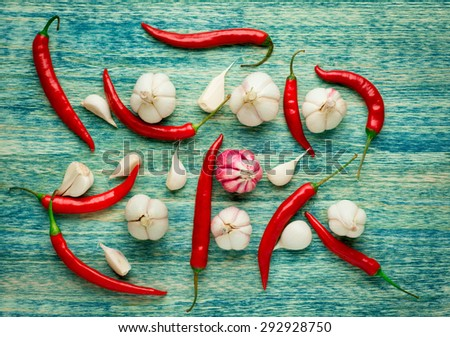 Red Hot Chili Peppers with herbs and spices over wooden background - cooking or spicy food concept.  - stock photo