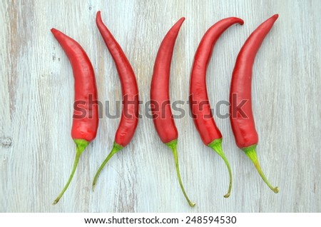 red hot chilli peppers on table - stock photo