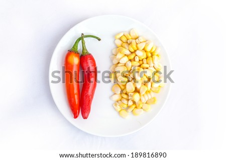 Red hot chilli peppers- Ripe corn isolated on white background - stock photo