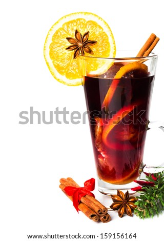 Red Hot Christmas mulled wine with spices, orange slice, anise and cinnamon sticks  isolated on white background, closeup. - stock photo