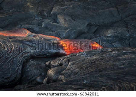 Red hot flowing lava - stock photo