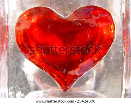 Red hot heart in cold ice - stock photo