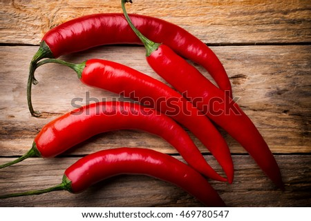 Red hot pepper on a wooden background. Studio photography.