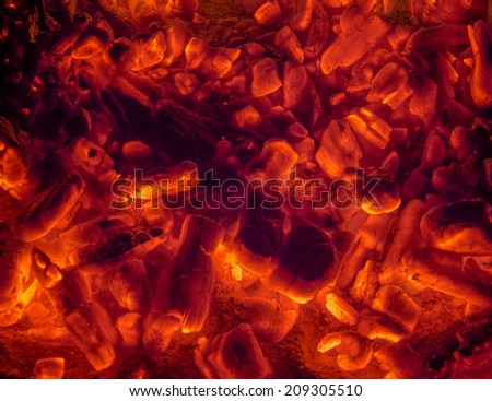 Red hot smoldering coals ready for frying - stock photo