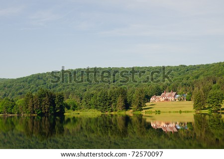 Red House Lodge overlooking Red House Lake - stock photo