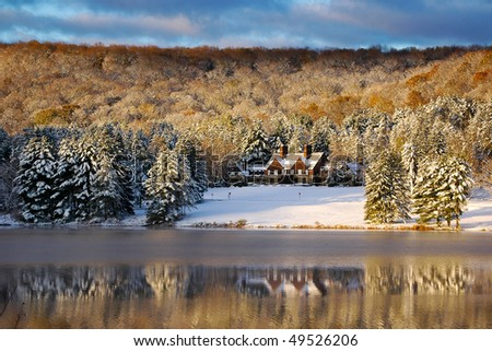 Red House Lodge visitor center over a lake reflection - stock photo