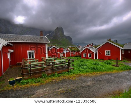 Red houses in Norway - Rorbuer on Lofoten - stock photo