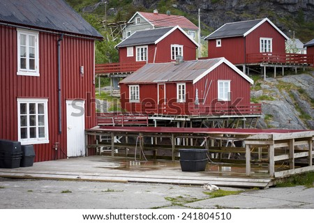 Red houses of the Fishing village in Lofoten Stockfish Museum Lofoten Tørrfiskmuseum